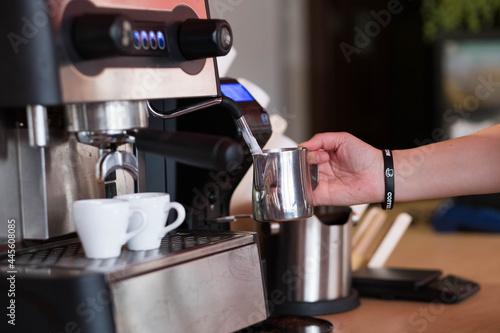 Fotografie, Obraz The espresso machine pours two coffees into white cups.