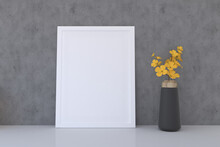 Frame With A Blank Canvas And A Vase With Flowers
