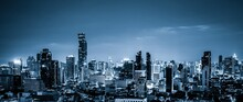 Blue-filtered Cityscape And High-rise Buildings In Metropolis City Center . Downtown Business District In Panoramic View .