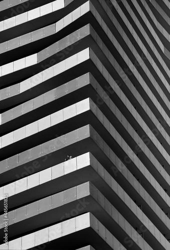 Fototapeta premium TORONTO, CANADA - Jun 06, 2021: Grayscale vertical shot of a modern building in Toronto, Canada