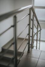 Vertical Shot Of Stairs With Metal Railings Indoors
