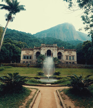 Natural View Of The Parque Lage In Rio De Janeiro, Brazil With A Fountain In The Foreground