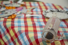 Closeup Of A Fallen Coffee Glass On A Messy Destroyed Picnic Table With A Colorful Checkered Cloth