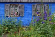 Casement Window In An Old, Blue Painted Wooden Country House In Mazovia, Poland