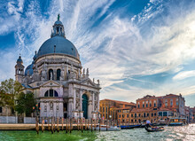Beautiful View Of Iconic Basilica Di Santa Maria Della Salute Or St Mary Of Health By Waterfront Of Grand Canal, Venice, Italy. Famous Landmark.