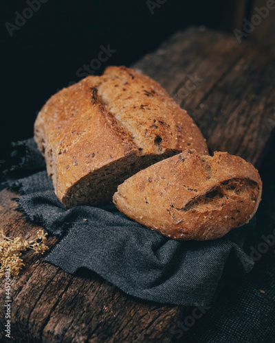 Obraz na plátne Sliced wholemeal rye bread enriched with many seeds in its composition