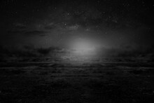 Black And White Photo Of A Dry Season Field On A Beautiful Starlit Night In The Sky.