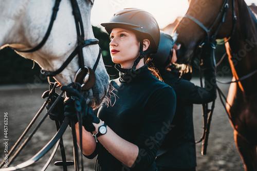 Fotografie, Obraz Young women enjoying with their horses.