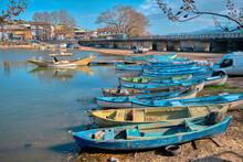 Golyaz (Apolyont), Uluabat Lake, Bursa Turkey. 22.01.2021. Old Lake Of Uluabat And Many And Large Group Of Small Fishing Boat On The Road With Dried Plants, Trees With Rocks On The Coast.