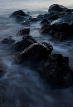 Rocks And Flowing Waves Along The Shoreline Of Camiguin Island