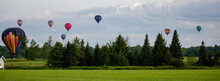 Near Wausau, Wisconsin, USA, July 10, 2021, Taste N Glow Balloon Fest. Hot Air Balloons Fill The Sky In Central Wisconsin