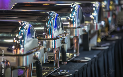 Fototapeta Row of closed buffet food dishes at party banquet hall