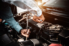 Car Care Maintenance And Servicing, Close-up Hand Technician Auto Mechanic Using The Wrench To Repairing Change Spare Part Car Engine Problem. Concepts Of Check And During Periodic Inspection Service.