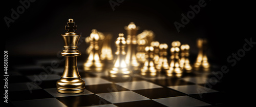 Vászonkép Close-up king chess standing first in line teamwork on chess board concepts of business team and leadership strategy and organization risk management