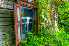 Windows Of An Abandoned House Inside The Chernobyl Exclusion Zone Near The Town Of Chernobyl, Ukraine