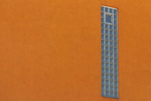 Vertical Window Build With Glass Blocks In A Orange Wall