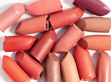 Various Cut Lipsticks On White Background. Makeup Product Sample.