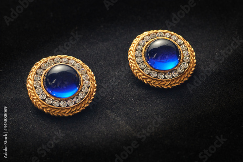 Fotografia, Obraz Golden vintage earrings from the eighties with gems inlaid on them