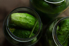 Fresh Cucumbers In Pickling Jars. Traditional Russian Snacks. Top View. Close-up.