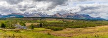 A Panorama View Back Towards The Nevis Range Of Mountains, Scotland On A Summers Day