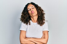 Middle Age Hispanic Woman With Arms Crossed Gesture Looking At The Camera Blowing A Kiss Being Lovely And Sexy. Love Expression.