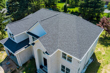 Aerial View Of Asphalt Shingles Roofing Construction, The House With New Window