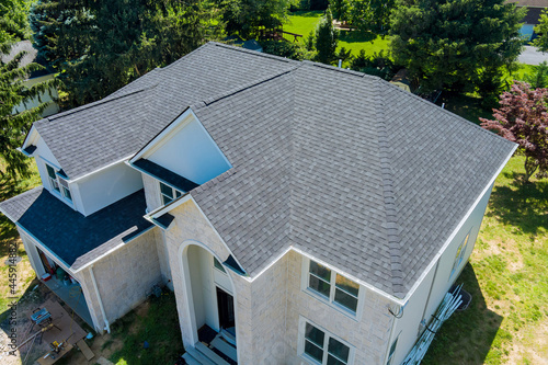 Fotografiet Aerial view of asphalt shingles roofing construction, the house with new window