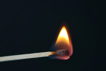 A Selective Focus Of A Match On Fire On Black Background