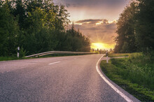 A Country Road In Germany At Sundown