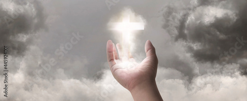 Fotografering Concept of new idea with Christian cross glowing symbol of Jesus on hand in 3D illustration