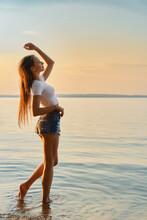 Positive Woman Enjoying Fresh Breeze During Sunset