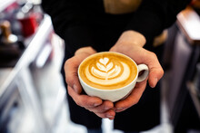 Close Up Of A Espresso Cup Held Gently In The Hands Of Barista