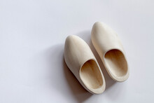 Top View Of One Pair Of Typical Handmade Dutch Wooden Shoes On White Background With Free Copy Space, Clogs Are A Type Of Footwear Made In Part Or Completely From Wood.