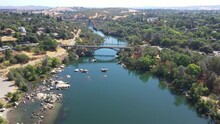 Aerial View Over Lake Natoma And Paddle Boarders And Kayakers On The River In Folsom.