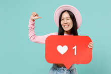 Confident Young Brunette Asian Woman 20s Wear Pink Clothes Pointing Thumb Fingers On Herself Hold Huge Like Sign From Social Network Heart Form Isolated On Pastel Blue Color Background Studio Portrait