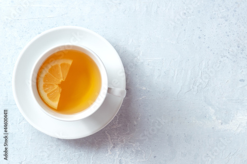 Fototapeta Lemon tea in a cup, shot from above with copy space