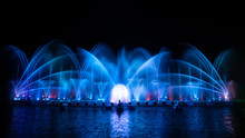 Colorful Fountain Dancing In Celebration Of Year With Dark Night Sky Background.