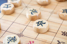Chinese Chess Pieces Written In Chinese Characters On The Chessboard
