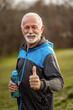 Leinwandbild Motiv Happy senior man is ready for exercising in park.