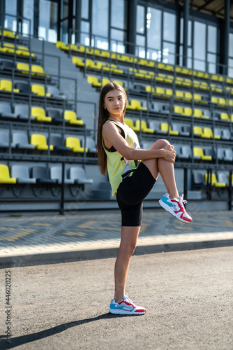 Fototapeta premium Fitness young lady doing morning stretching workout