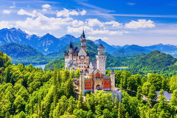 Neuschwanstein Castle, Germany. Front view of the castle with the Bavarian Alps in the background.