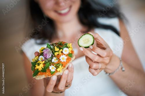 Murais de parede happy smiling young woman holding vegan cream cheese Whole grain bread or toast