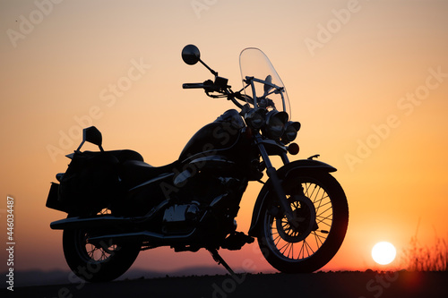 Fototapeta Motorcycle parking on the road right side and sunset