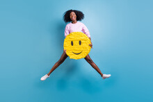 Full Size Photo Of Young Happy Excited Smiling Afro Girl Jumping With Huge Smile Emoji Isolated On Blue Color Background