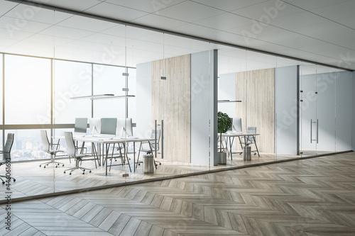 Obraz na plátně Sunny hall of modern office area with parquet, stylish workspaces, wooden decora
