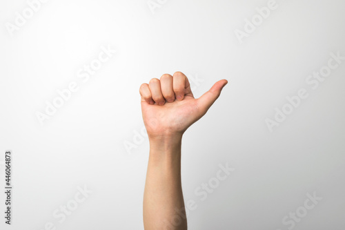 Fototapeta A man's hand making an expression on a white background
