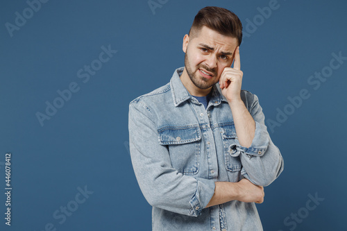 Canvas Print Sick ill aggrieved stressed young brunet man 20 wear denim jacket put hands on h