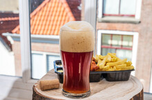 Drinking Dark Beer With Fried Cod Fish Fillet And French Fried Potatoed Chips With View On Street In Old Zierikzee Town, Zeeland, Netherland