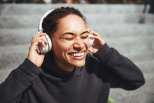 Merry Lady Enjoying Her Music With Her Eyes Shut
