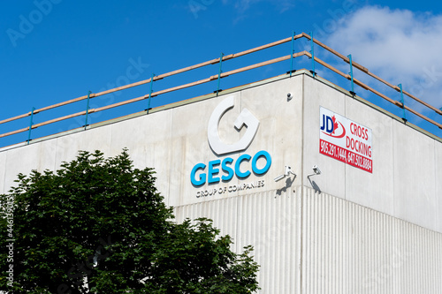 Fototapeta premium Brampton, On, Canada - July 10, 2021: Close up of Gesco Group of Companies sign on the building in Brampton, On, Canada. The Gesco Group of Companies is a Canadian floor covering organizations.